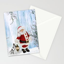 Santa Claus with funny penguin Stationery Cards