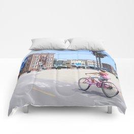 Riding bike in Venice Beach Comforters