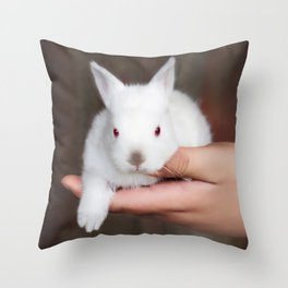 Bunny in hand Throw Pillow