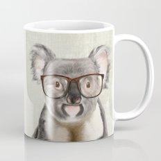 A baby koala with glasses on a rustic background Mug