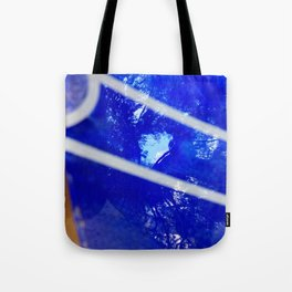 Tree reflection in blue glass Tote Bag