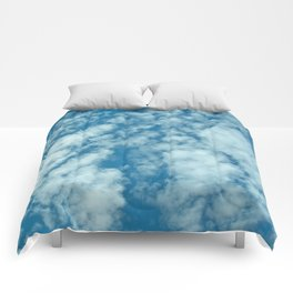 Fluffy clouds in a blue sky Comforters