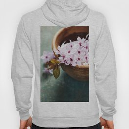 spring flowers for spa and aromatherapy over wooden background Hoody