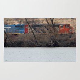Train by River in late fall Rug