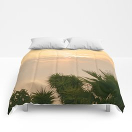 cloudy sky in the oasis Comforters