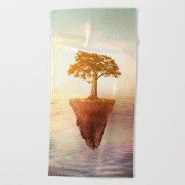 Floating tree Beach Towel