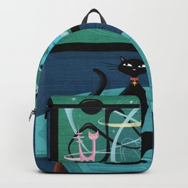Creature Comforts Mid-Century Interior With Black Cat Backpack