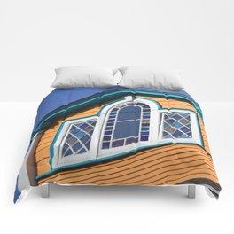 Orange House with multicolored vitreaux Comforters