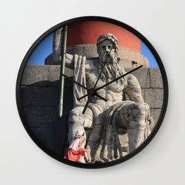Figure of a man with a paddle sitting at the foot of the Rostral column. A little girl jumps over he Wall Clock