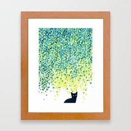 Cat in the garden under willow tree Framed Art Print