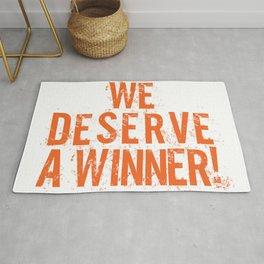 We Deserve A Winner Rug