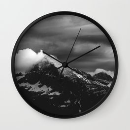 White clouds over the dark mountains Wall Clock