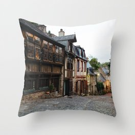 Old street in the town of Dinan at dusk Throw Pillow
