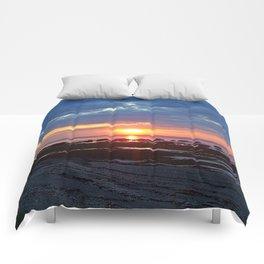 Sunset under Stormy Skies Comforters