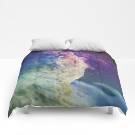 Astronaut dissolving through space Comforters