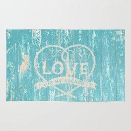 Maritime Design- Love is my anchor on aqua grunge wood background Rug