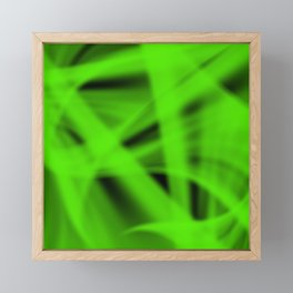A flowing pattern of smooth green lines on the fibers of the veil with bright luminous transitions. Framed Mini Art Print