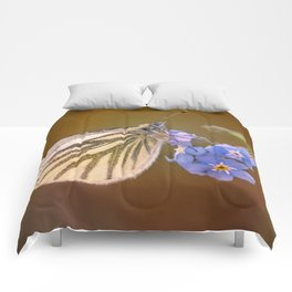 White and cream butterfly on forget-me-not flowers Comforters