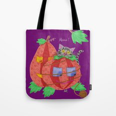Cat behind pumpkins on a purple background . Tote Bag