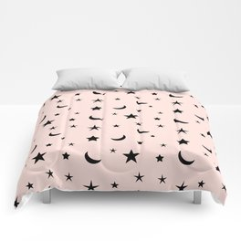 Black moon and star pattern on pink background Comforters