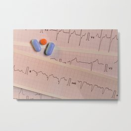 Colored pills on electrocardiogram strips Metal Print