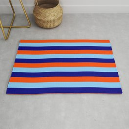Blue, Red, and Light Sky Blue Colored Pattern of Stripes Rug