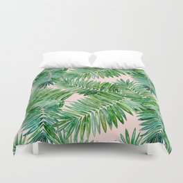 Green palm leaves on a light pink background. Duvet Cover
