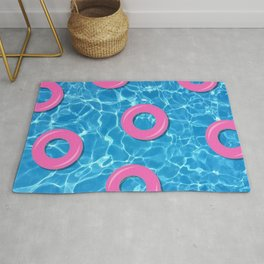 Pink Rubber Rings on Swimming Pool Water Rug