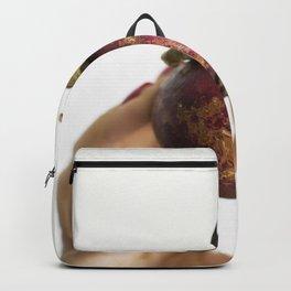 Hand holding a fresh mangosteen Backpack