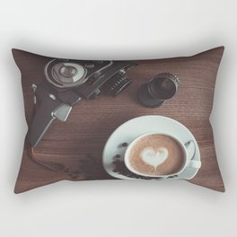 A cup of hot cappuccino placed on a table next to the old camera Rectangular Pillow