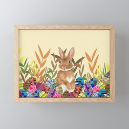 Bunny in garden with colored Easter eggs Framed Mini Art Print