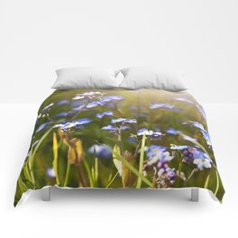 Forget me not flowers in sunlight Comforters