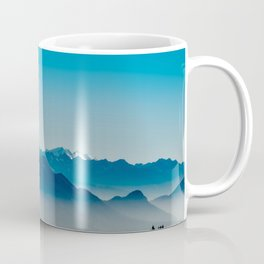 Rise above the mist. Blue Coffee Mug
