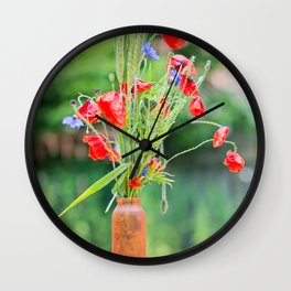 Bunch of of red poppies, cornflowers and ears of barley, wheat and rye on the table. Wall Clock