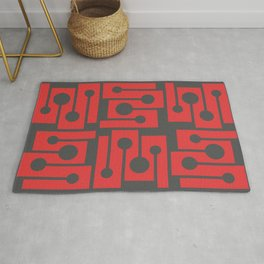 Red angles and dots. Clear geometric shapes.  Rug