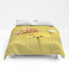 Orange butterfly feeding on yellow marigolds Comforters