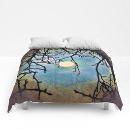 eerie moon Comforters