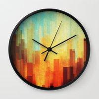 cityscape Wall Clocks featuring Urban sunset by SensualPatterns