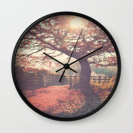 Sunlight shines through silhouetted tree. Wall Clock