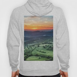 Beautiful sunset behind green fields Hoody