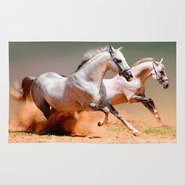 two white horses running Rug