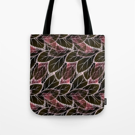 Bright leaves on a black background. Tote Bag