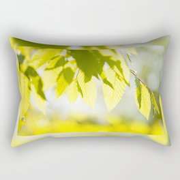 Young Elm leaves on blurred green Rectangular Pillow