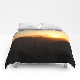 grand sunrise Comforters