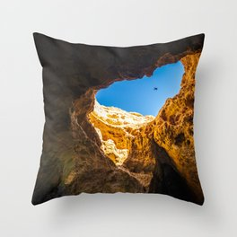 Dramatic sea cave along Algarve coast in Portugal Throw Pillow