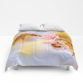 Honey bee on a sakura flower Comforters