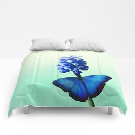 Blue bells on wings Comforters