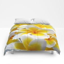 Frangipani halo of flowers Comforters
