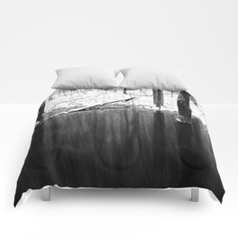 Snowing on water Comforters