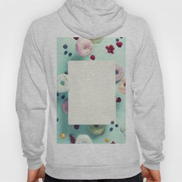 Sweet and colourful doughnuts with sprinkles and berries falling or flying in motion Hoody